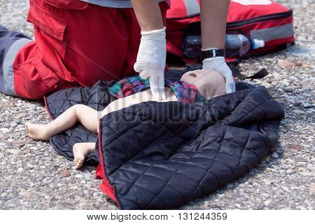 Infant dummy first aid. Cardiopulmonary resuscitation - CPR.
