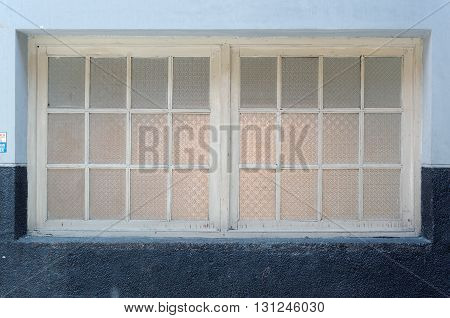 the old textured glass window in railway station