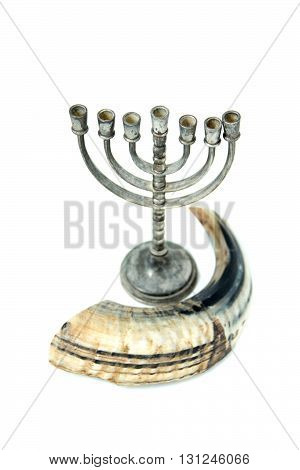 shofar and menorah candlestick is isolated white background