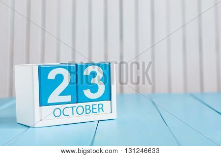 October 23rd. Image of October 23 wooden color calendar on white background. Autumn day. Empty space for text.