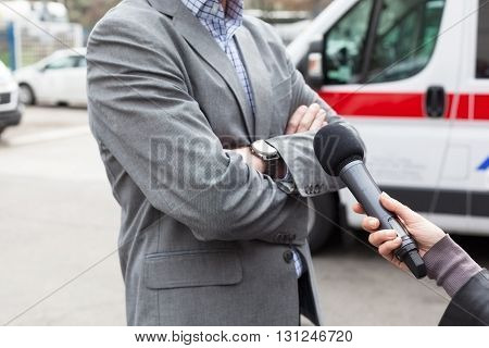 Save Download Preview Reporter holding a microphone conducting an TV or radio interview