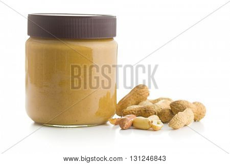 Creamy peanut butter and peanuts  isolated on white background. Spreads peanut butter in the jar.