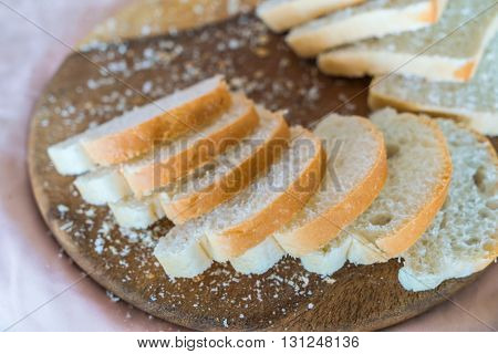 Sliced white bread on wood