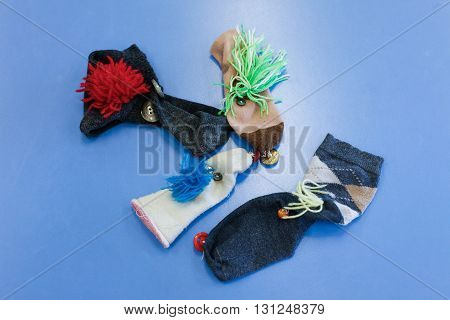 Do-it-yourself hand and finger puppets made of socks. Learning through experience concept creative playing and educational approach concept.
