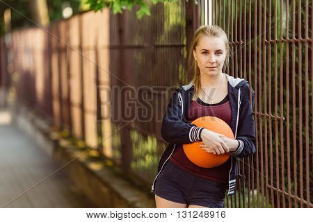 Sporty Girl Standing With Basketball Ball