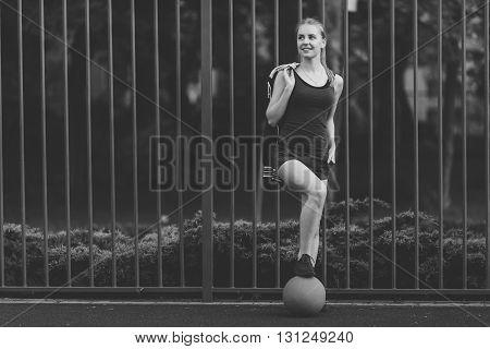 Sporty Girl Standing With Basketball Ball