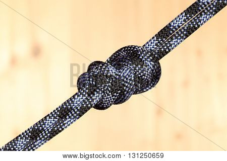 grey rope with eight knot in the middle