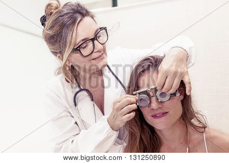 Specialist In Ophthalmology Test New Lenses On A Patient With Phoropter