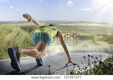 poster of Running athlete man. Male runner sprinting during outdoors training for marathon run. Athletic fit young sport fitness model in his twenties in full body length on road outside in nature.