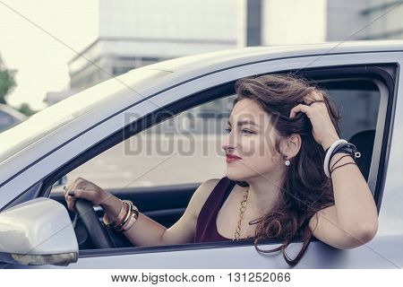 Woman Looks Out The Car Window