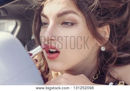 Woman Doing Make-up While She Sits In The Car
