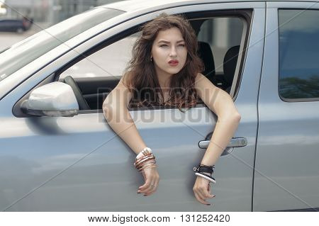 Woman Is Driving A Car.
