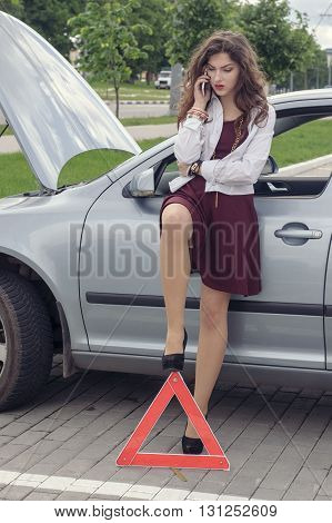 Woman Opened Hood Of The Car