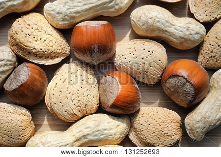 close-up macro of almonds hazelnuts and peanuts