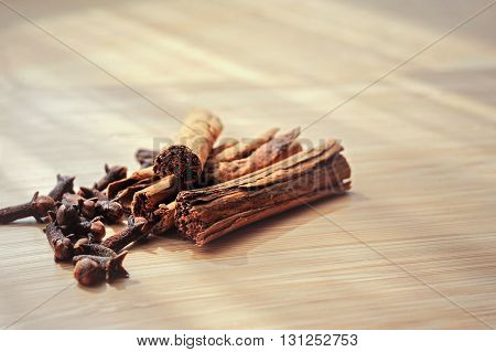 close-up of spice cinnamon clove on a wooden board