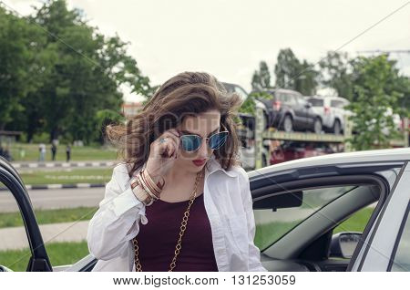 Woman In Sunglasses Out Of The Car