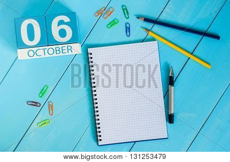 October 6th. Image of October 6 wooden color calendar on blue background. Autumn day. Empty space for text.