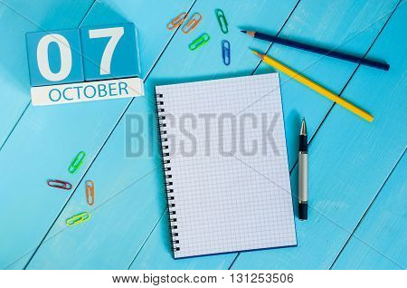 October 7th. Image of October 7 wooden color calendar on blue background. Autumn day. Empty space for text.