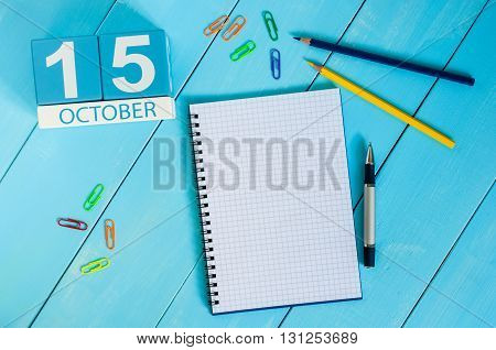 October 15th. Image of October 15 wooden color calendar on blue background. Autumn day. Empty space for text.