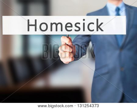 Homesick - Businessman Hand Holding Sign