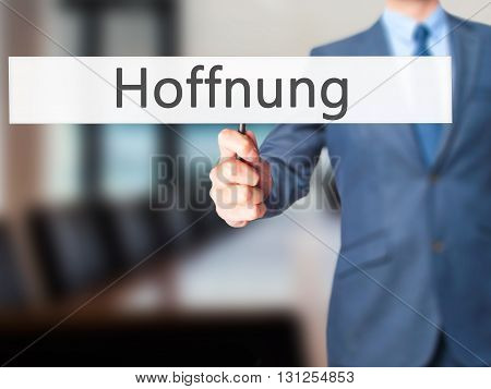 Hoffnung (hope In German) - Businessman Hand Holding Sign