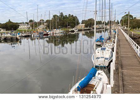 Boats, yachts mooring along the Moyne River in Port Fairy, a coastal town in Victoria, Australia.