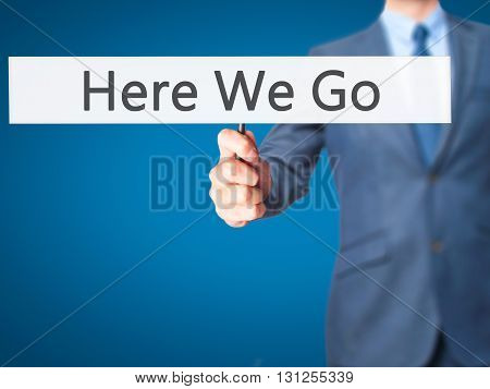 Here We Go - Businessman Hand Holding Sign