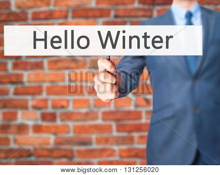 Hello Winter - Businessman Hand Holding Sign
