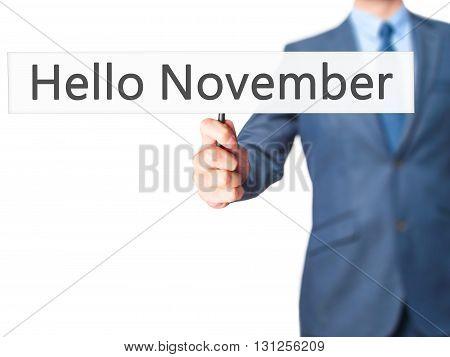 Hello November - Businessman Hand Holding Sign