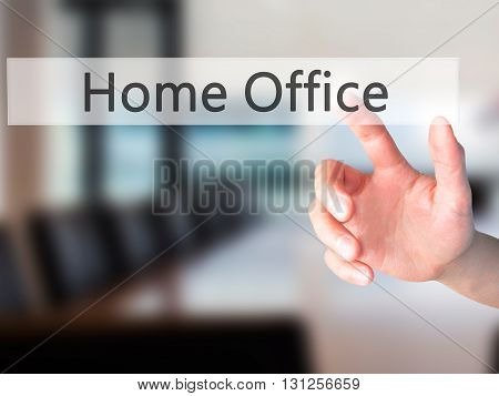 Home Office - Hand Pressing A Button On Blurred Background Concept On Visual Screen.