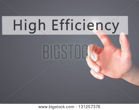 High Efficiency - Hand Pressing A Button On Blurred Background Concept On Visual Screen.