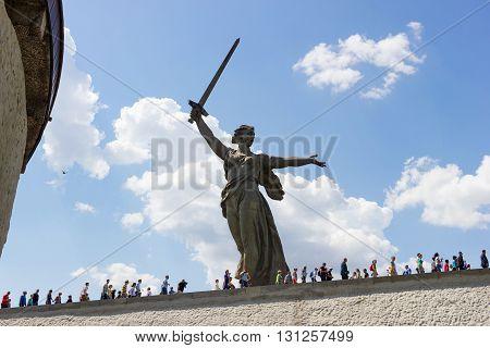 VOLGOGRAD RUSSIA - May 09 2016: People go to the Monument the Motherland calls! Mamayev Kurgan Volgograd Russia
