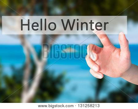 Hello Winter - Hand Pressing A Button On Blurred Background Concept On Visual Screen.
