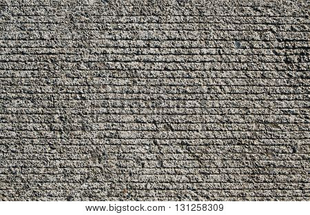 Close up of grey pavement or cement.