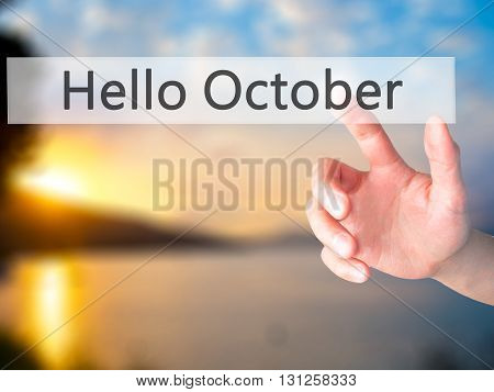 Hello October  - Hand Pressing A Button On Blurred Background Concept On Visual Screen.
