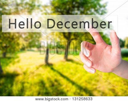 Hello December - Hand Pressing A Button On Blurred Background Concept On Visual Screen.