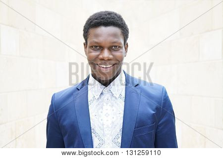 happy young man of african descent with toothy smile