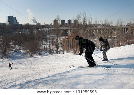 VOLGOGRAD RUSSIA - FEBRUARY 05 2012:People are skiing down the hill in the city