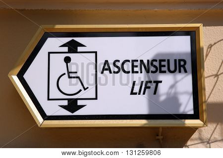 Sign Showing Direction for the Lift in English and French