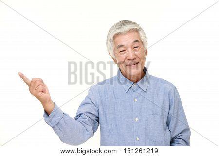 portrait of senior Japanese man presenting and showing something on white background
