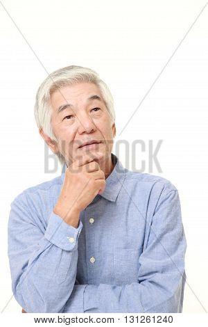 senior Japanese man dreaming at his future