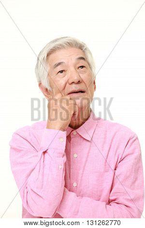 senior Japanese man thinks about something on white background