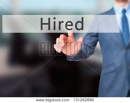 Hired - Businessman Hand Pressing Button On Touch Screen Interface.