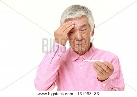 portrait of senior Japanese man with fever on white background