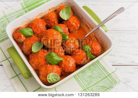 meatballs with tomato sauce on wooden background