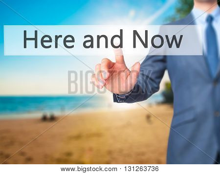 Here And Now - Businessman Hand Pressing Button On Touch Screen Interface.
