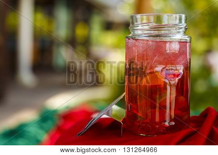 glass jar with fruit juice and ice