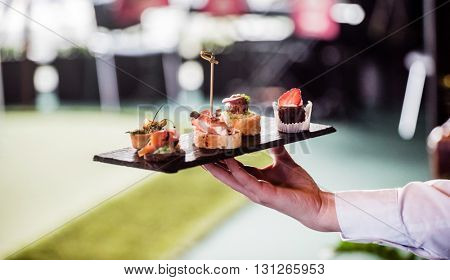 waiter with spanish appetizer