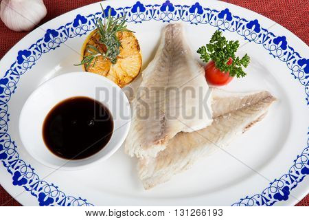 White fish fillet with soy sauce and herbs