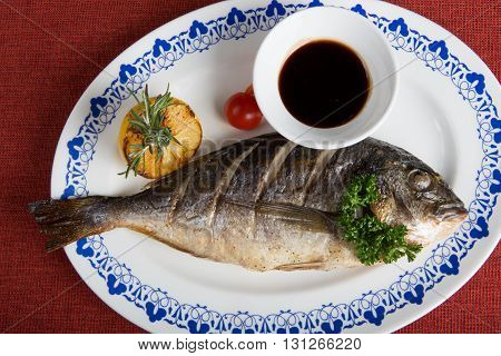 Dorado fish grilled with soy sauce and herbs